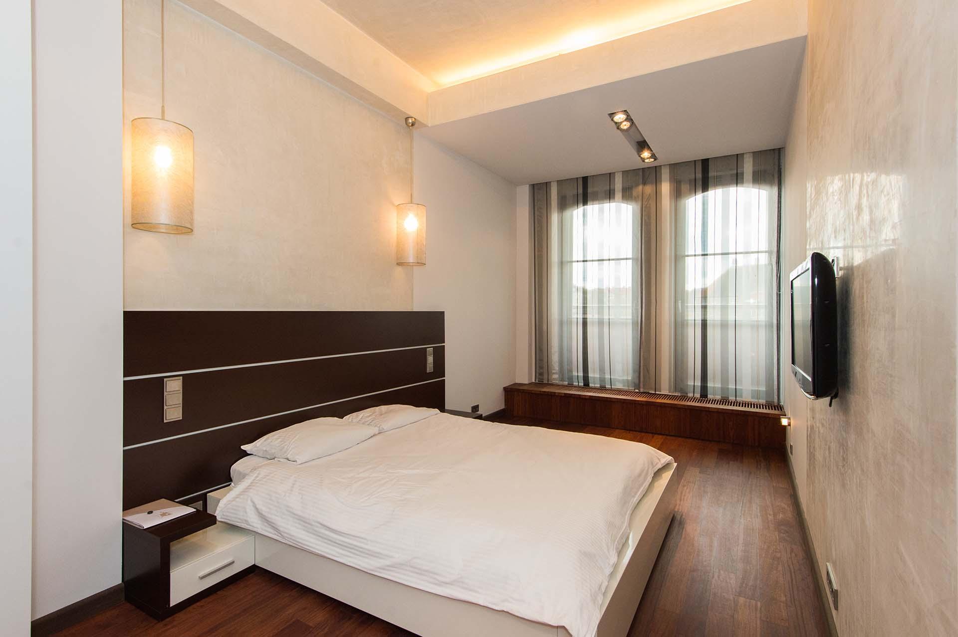 sypialnia w apartamencie poznań